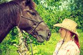 Animal And Human Love, Equine Concept. Western Woman Taking Care Of Horse On Green Meadow poster