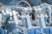 Close Up View - Moving Parts Of Hydraulic Industrial Automotive Machine Tool Equipment. Abstract Ind poster