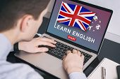 Man Working On Laptop With Learn English On A Screen. Education Learning English Language School Con poster