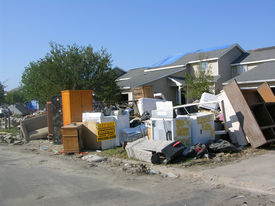 stock photo of katrina  - hurricane katrina flood damage cleanup  note: name of company on roofing sign obviously changed to fictitious name & fake phone #. (although, it
