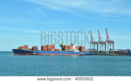 Container stack, ship and tugboat
