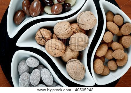 Detail Of Almonds In Chocolate And Walnuts