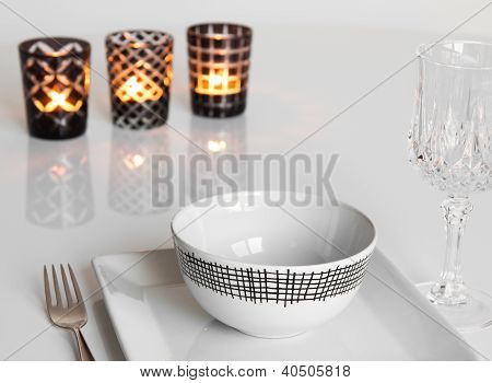 Table Setting With Three Candles