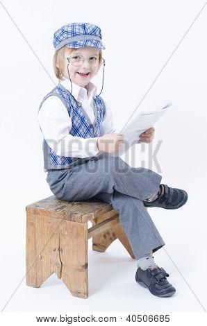 Cute Boy Reding Newspaper