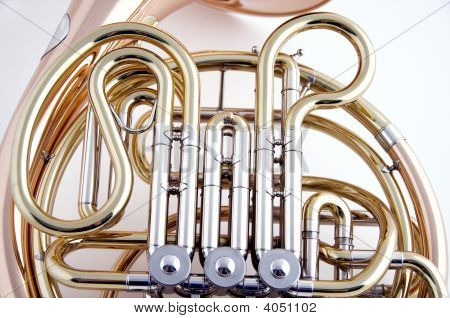 Gold Brass And Coper French Horn Isolated On White