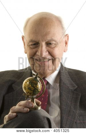 Senior Bussinessman Looking At A Small Globe,