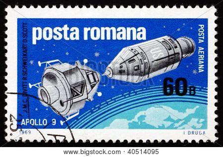 ROMANIA - CIRCA 1969: a stamp printed in the Romania shows Apollo 9 and Lunar Landing Module over Earth, US Space Explorations, Apollo 9 and 10, circa 1969