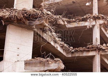 Destruction of old iron rebar concrete building