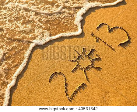 2013 written in sand on beach texture, soft wave of the sea.
