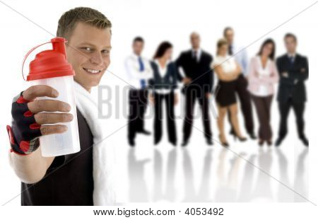 Young Guy Showing Sipper Bottle And His Team Standing On His Back