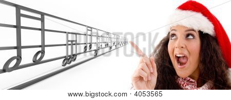 Woman With Christmas Hat Indicating The Musical Notes