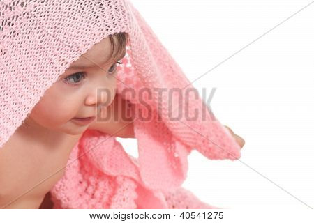 Active Baby Under A Pink Blanket