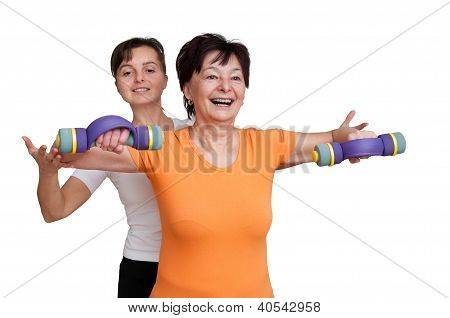 Coach assisting senior woman exercising