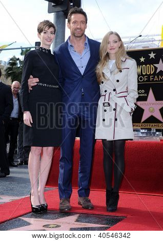 LOS ANGELES - DEC 12:  Anne Hathaway, Hugh Jackman & Amanda Seyfried  arriving to Walk of Fame Honors Hugh Jackman on December 12, 2011 in Hollywood, CA