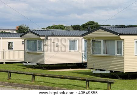 Caravan mobile homes in modern trailer park.
