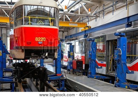 PRAGUE, CZECH REPUBLIC - SEPTEMBER 17: Renovation of classic Czech tram type T3 in workshop in Depot Hostivar on Open Doors Day in the Prague Public Transport Company on September 17, 2011 in Prague, Czech Republic.
