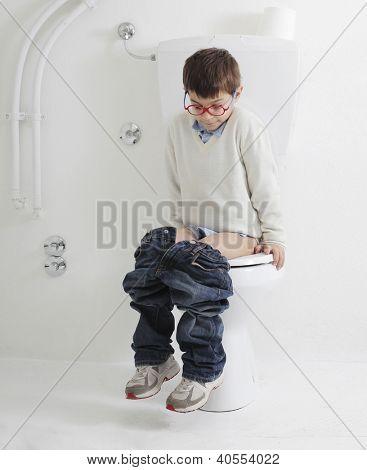 Child sitting on a toilet