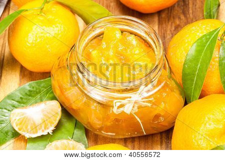 orange mandarin jam marmelade in a glass jar