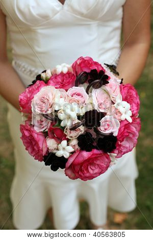 Bride Holding Pink and White Bouquet