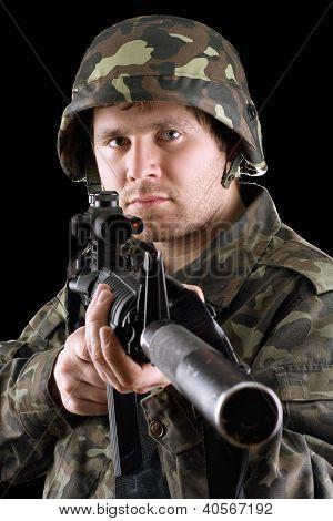 Soldier Holding A Gun In Studio