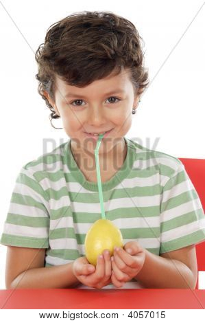 Adorable Boy Drinking Juice Of Lemon