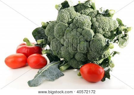 green broccoli with red tomatoes and peppers
