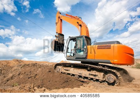 Excavator moves with raised bucket