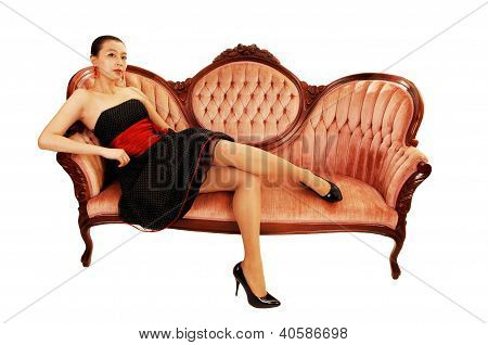 Asian Girl Sitting On Sofa.