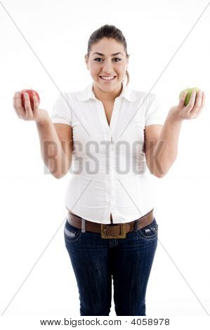 Young Attractive Model Holding Apples In Both Hands