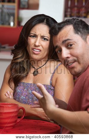 Disgusted Woman With Man In Cafe