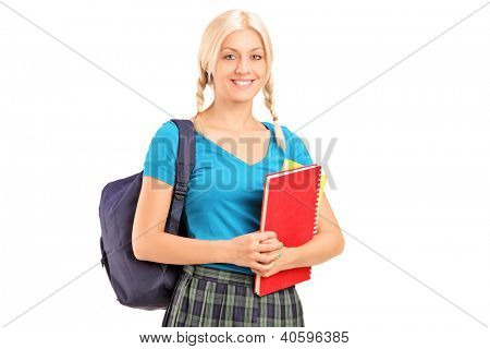 A female student standing with school bag and holding books, isolated on white background