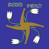 stock photo of swastika  - Imbolc greeting card with a cross of Goddess Brigid and first spring flowers - JPG
