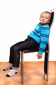 Young Boy On Chair