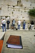 stock photo of tora  - Jewish bible on table wailing western wall jerusalem israel  - JPG
