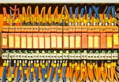 stock photo of busbar  - Set of Orange terminal blocks located inside of a control panel - JPG