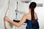 foto of mammogram  - Woman Taking A Mammogram X - JPG