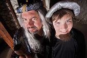 stock photo of sceptre  - Caucasian father and son wizards standing next to each other - JPG