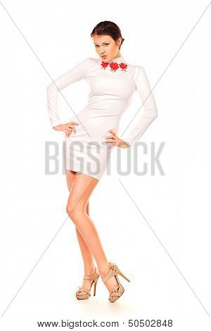 Charming pretty woman posing in a beautiful white dress. Isolated over white.