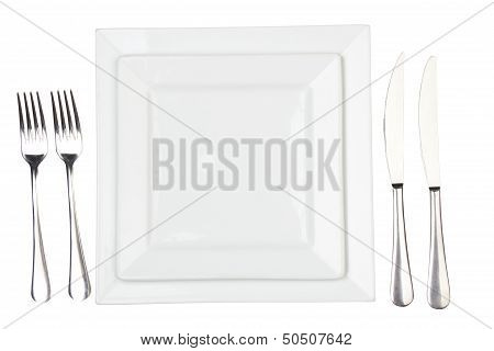 Place Setting With High-gloss Plate, Knife & Fork.
