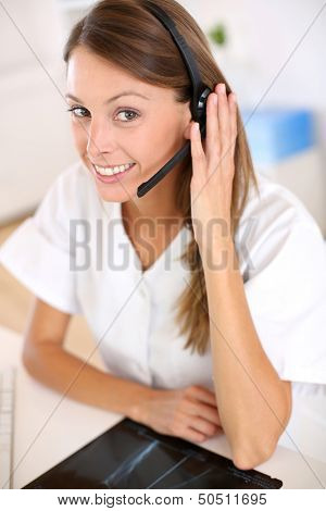 Portrait of smiling nurse with headset on