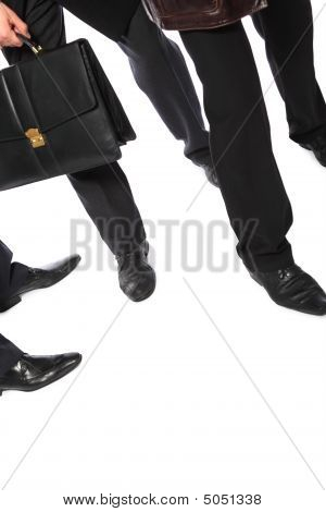 Legs Of Businessmen And  Briefcase In Hand