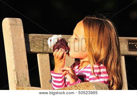 Cute Girl Eating Cupcake