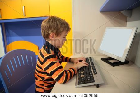 Boy At Computer In Children's Room