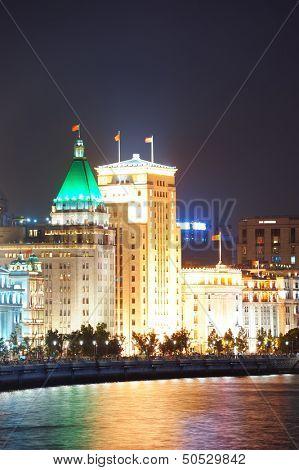 Shanghai Waitan night view with historic buildings over Huangpu River