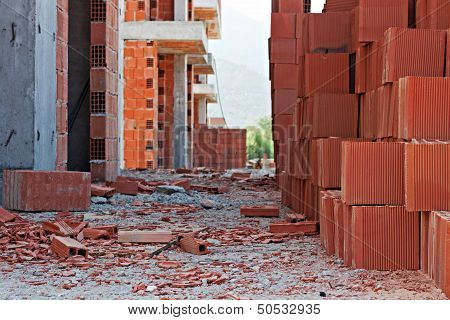 Stack Of Red Building Blocks On Messy Site