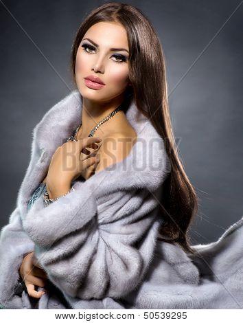 Beauty Fashion Model Girl in Blue Mink Fur Coat. Beautiful Luxury Winter Woman. Grey Mink Jacket Wear