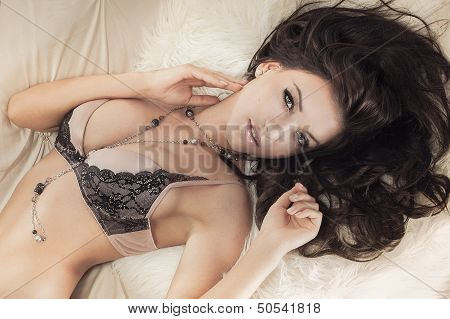Sexy Young Woman In Lingerie Lying.