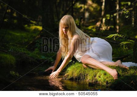Woman On Creek
