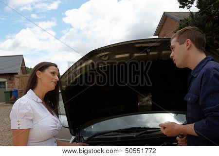 A Mechanic Talking To A Female Customer