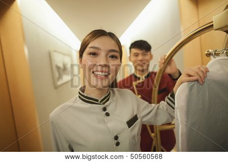 Bellhops in the doorway smiling, portrait